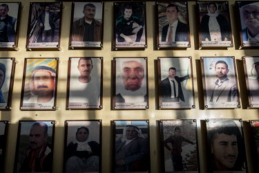 Photographs of the 103 Yazidi victims of ISIS, murdered in 2014, are displayed in the school building where ISIS extremists rounded up the boys, men and elderly women of the village before killing the...