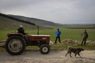Professor Yasar Ergun and his colleague Hasan Dinler talk with a passing farmer driving a tractor along a track in the protected zone he helped create for the nearly extinct mountain gazelle (Gazella...