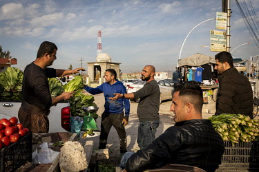 A market vendors selling lettuce in the central market.   Prior to being overrun by ISIS in August 2014 the town was majority Christian but following its liberation, on 20 October 2016 by Iraqi Specia...