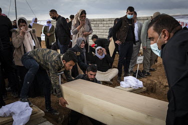 A Yazidi family bury the remains of a relative, one of 103 people from the village murdered by ISIS in 2014. Having been exhumed from the mass graves where they were dumped by ISIS, the victim's remai...