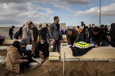 A Yazidi family bury the remains of a young male relative, one of 103 people from the village murdered by ISIS in 2014. Having been exhumed from the mass graves where they were dumped by ISIS, the vic...