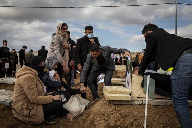 A woman collapses as her family bury the remains of a young male relative, one of 103 Yazidis murdered by ISIS in 2014. Having been exhumed from the mass graves where they were dumped by ISIS, the vic...