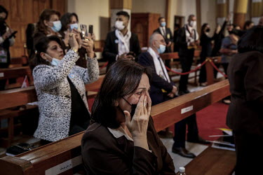 A woman cries as she witnesses Pope Francis' visit to the Our Lady of Salvation church in Baghdad during the first Papal visit to Iraq.
