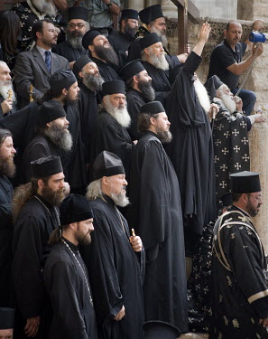 Greek Orthodox monks gathered during the Easter at the entrance of the Holy Sepulchre church.