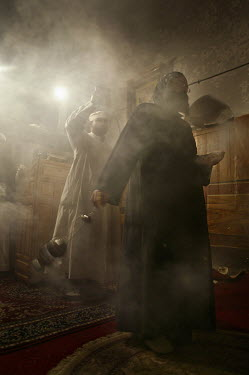 Monks swing inscence burners as they perform midnight prayers at the Monastery of St Paul the Anchorite, also known as the Monastery of the Tigers, a Coptic Orthodox monastery dating back to the 4th C...