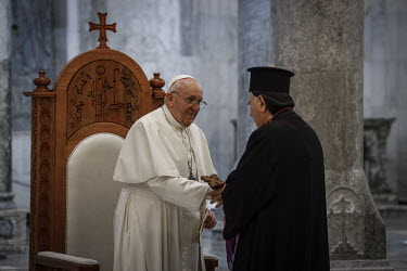 Pope Francis meets clergy in the Church of Immaculate Conception, in the mainly Christian town of Qaraqosh, where he was due to hold mass.