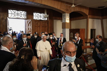 Pope Francis is welcomed to the Our Lady of Salvation church in Baghdad during the first Papal visit to Iraq.