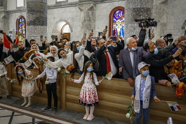 Crowds of people welcome Pope Francis to the Church of Immaculate Conception, in the mainly Christian town of Qaraqosh, where he was due to hold mass.