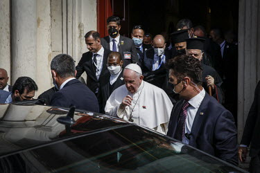 Pope Francis leaves the Church of Immaculate Conception, in the mainly Christian town of Qaraqosh, where he held mass.
