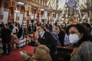 Excited members of the congregation use their mobile phones to trake pictures of Pope Francis as he holds mass in the Church of Immaculate Conception in the mainly Christian town of Qaraqosh.