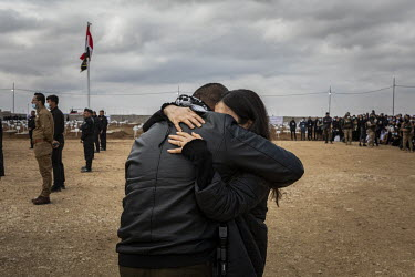 Nobel Peace Prize Laureate Nadia Murad cries as she is embraced by her brother Khalid during the funeral ceremony for 103 Yazidi victims of ISIS, including two of their brothers, who mudered and dumpe...