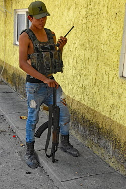 Members of 'Los Viagras', an armed vigilante group that call themselves 'grupos de autodefensas' (self-defence militias), on patrol. The controversial vigilante organisation began as a reaction to the...