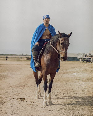 Dozhan Baysgalan from Mongolia, a competitor in Er Enish (horseback wrestling) at the World Nomad Games.