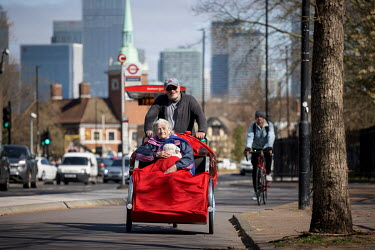 Doug, a volunteer for Cycling Without Age an organisation providing cycle rides for the elderly on specially designed trishaws, takes his mother Patricia for a ride around Southwark.