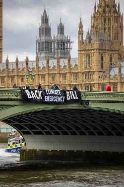 A banner supporting the The Climate and Ecological Emergency Bill (CEE Bill), hangs from Westminster Bridge, beside the The Palace of Westminster. The CEE Bill is supported by over 100 MPs from eight...