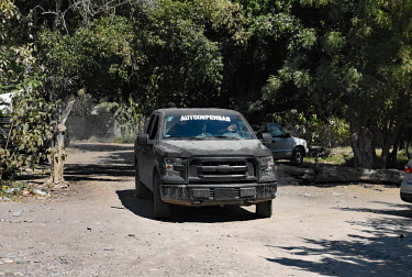 Members of 'Los Viagras', an armed vigilante group that call themselves 'grupos de autodefensas' (self-defence militias, patrol in a vehicle thta is painted black and marked with 'autodefensas'. The c...