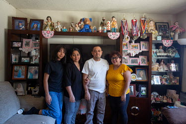 Rosa Barrientos and her family at their home.  Rosa Barrientos, 26, migrated with her family from Guanajuato, Mexico to the U.S. when she was four years old. She never talked with her parents about be...