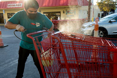 Osvaldo Ozuna, 27, collects trolleys and baskets and then sanitises them at Trader Joe's, a grocery store in Santa Monica. Ozzy is Deferred Action for Childhood Arrivals (DACA) recipient and an essent...