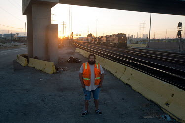 A Deferred Action for Childhood Arrivals (DACA) recipient who works at the BNSF Railway, Alejandro Ortega Picon stands in the Hobart Yard, where he works.  Alejandro came to the United States from Gua...