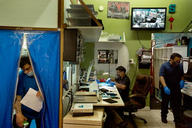 Jonathan Suarez, 33, works at his desk in his store, ScreenCure, a mobile phone repair shop where he employs five people. Jonathan is a Deferred Action for Childhood Arrivals (DACA) recipient who came...