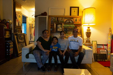 Noraney Ocampo, 38, with her family at her house in Los Angeles.   Noraney Ocampo is a middle school teacher at 'Para los Ninos' school in Los Angeles. She came to the USA at the age of 10. Her moth...