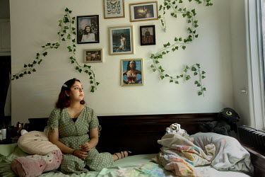 Ana Zamora, Deferred Action for Childhood Arrivals (DACA) recipient, sits on her bed beneath pictures of women who she looks up to and admires.   Ana Zamora, 21, came to the United States from Tijua...