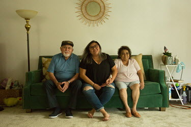 Karina Pantoja sits on a couch she just purchased with her father and mother, Jesus and Ines, at their apartment in Whittier.  Karina Pantoja was born in Merida, Yucatan, Mexico, and came to the Unite...