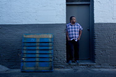 Carlos, 27, (not real name) stands in an alley outside his workplace. When he was seven he left Michoacan, Mexico with his mother who was escaping a violent situation. He works as an office administra...