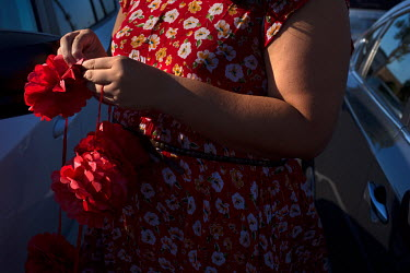 Gloria Itzel Montiel, 33, opens paper flowers, which she will hang on her car when she congratulates students from Santa Ana High School for receiving the scholarship that she created. Gloria gave a t...