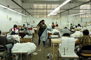 Gisel Villagomez, 33, the project and contracting manager at 3K Apparel Inc, her sister's garment factory. Gisel is a Deferred Action for Childhood Arrivals (DACA) recipient and an essential worker wh...