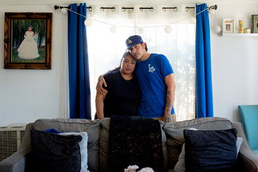Gisel Villagomez, 33, with her husband, Tony Flores, 39, in their house. She is the project and contracting manager at 3K Apparel Inc, her sister's garment factory. Gisel is a Deferred Action for Chil...