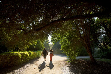 Alejandro Ortega Picon walking with his girlfriend, Stephanie Reinoso, at the Los Angeles County Arboretum in Arcadia. He says the fig trees and the flowers of the gardens bring him back to his grandm...