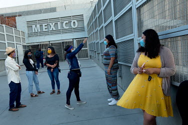 Gloria Itzel Montiela, 33, (yellow dress) stands at the border of Mexico and the United States with other Deferred Action for Childhood Arrivals (DACA) recipients in a trip she organised to San Ysidro...