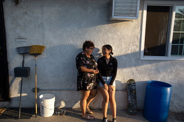 Rosa Barrientos and her sister Samantha in East Los Angeles at her home where they live with their parents. She moved to Sacramento for college and worked in DC for CHIRLA, but came back to work in LA...
