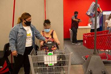 Teissy Angel takes her client Yvonne Garcia, 52, who has intellectual disabilities, shopping. Some of Teissy's duties are to make sure all Garcia's medical records are updated, assisting her with budg...
