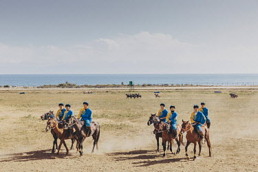 Kazakh Kok-Boru players warm up their horses in preparation for their 3rd place play-off match with Russia at the World Nomad Games.