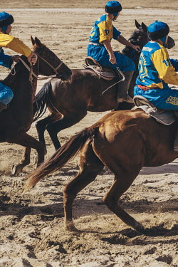 Kazakh Kok-Boru players charge onto the pitch during the 3rd place play-off match at the World Nomad Games.