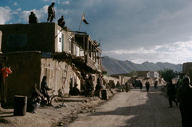 People and housing along the main road through Bamyan.