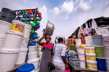 Traders and shoppers browse the stalls in Kejetia market (Kumasi Central Market). The market is thought to be amongst the largest in Africa, with over 10,000 individual stores.