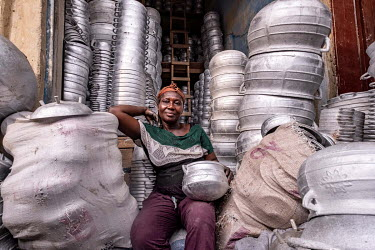 Yaa Akoto (60) in her stall in Kejetia market (Kumasi Central Market). Akoto makes cooking pots out of recycled aluminium.