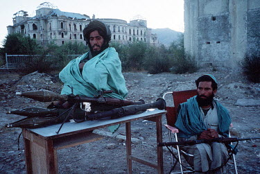 Taliban fighters in front of the destroyed Darum Aman Palace.