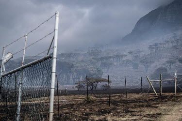 Smoke hangs over the slopes of Table Mountain after a wildfire ripped through the area.