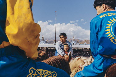 Kazakh Kok-Boru players discuss tactics with one of the team's coaches ahead of their 3rd place play off match with Russia at the World Nomad Games.