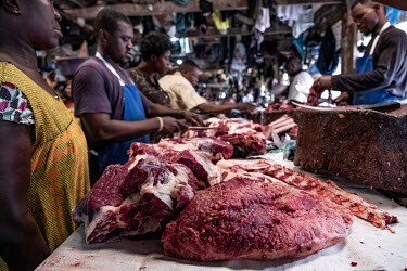Butchers sell beef at Kejetia market (Kumasi Central Market).