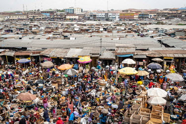Shoppers and traders in Kejetia market (Kumasi Central Market). The market is among the largest in Africa, with more than 10,000 stalls selling virtually everything imaginable.