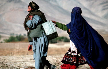 A couple fleeing the fighting between Commander Massoud's forces and the Taliban.
