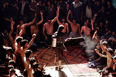 Shia Muslims commemorate Ashura inside a mosque in the Chindawol district.