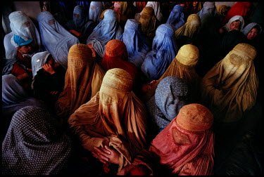 Burkha clad women crowded in to the female section of a mosque in the Chindawol district.