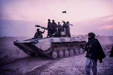 Troops loyal to Commander Massoud travel in an armoured vehicle towards the frontline in order to confront the Taliban.