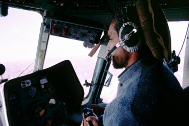 Commander Ahmad Shah Massoud, flying his helicopter as co-pilot.